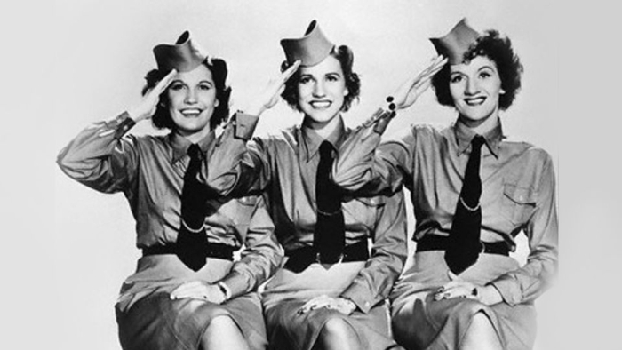 The Andrews Sisters posing in World War two era uniforms